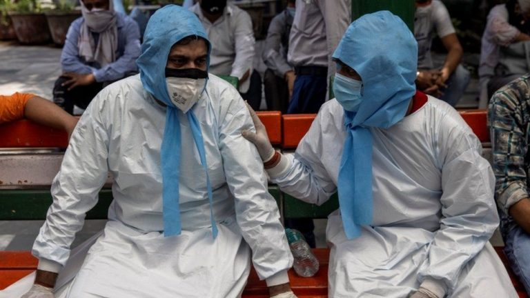 India Covid: Hospitals overwhelmed as deaths pass 200,000